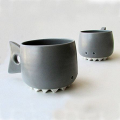Thumbnail image for dino handles and smiley mugs