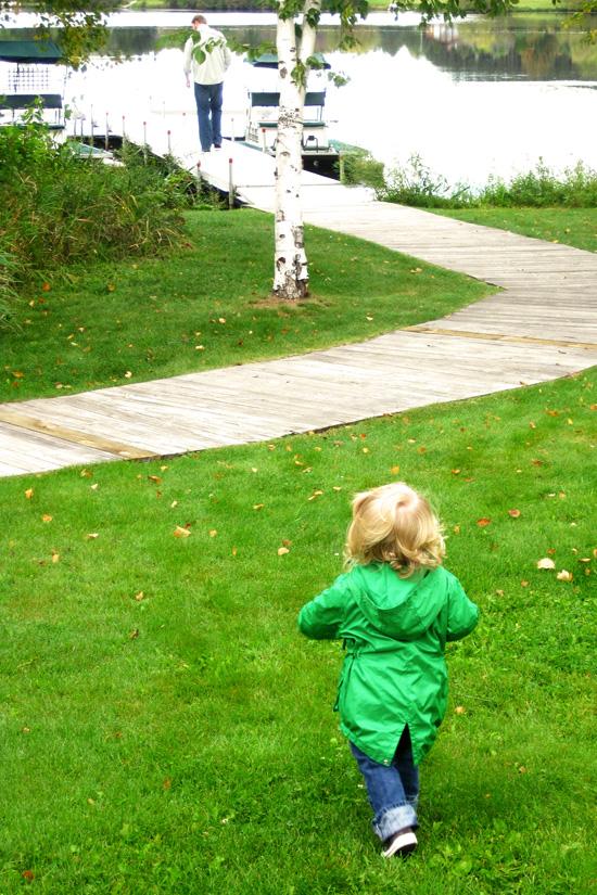 toddler running to the lake